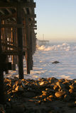 Ocean Wave Storm Pier. Ocean waves throughout at storm crashing into a wooden pier Stock Photography