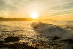 Ocean wave sun Stock Photography