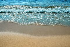 Ocean wave surf breaking on beach Royalty Free Stock Photography