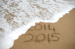 Ocean Wave washing away 2014 and leaving 201 Stock Image