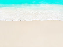 Ocean wave and white sand at tropical beach, island Praslin, Sey. Chelles - vacation background Stock Photos