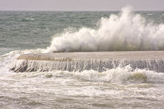 Ocean waves. Furious ocean waves are hitting to a concrete dock royalty free stock image