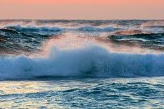 Ocean waves. Waves crashing at sunset on the coast Royalty Free Stock Photos