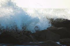 Ocean waves. Waves crashing on rocks Stock Photos