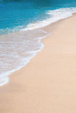 Ocean waves. Gentle waves on beach scene with sandy shore, plenty of copy space Stock Image