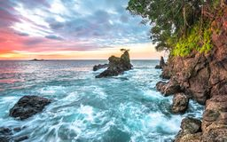 Free Ocean Waves And Coastal Cliffs At Sunset In Costa Rica Royalty Free Stock Image - 142278176