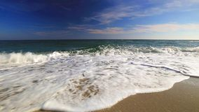 Ocean waves on the beach. Blue sky and ocean waves on the beach stock footage