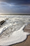 Ocean waves. Beach and foamy ocean waves washing up on beach Stock Photos