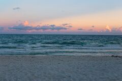Ocean Waves on Beach at Sunset Royalty Free Stock Images