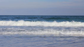 Ocean waves with a blue sky background. (Full HD stock footage