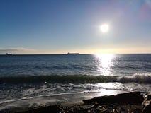 Ocean waves boats sunny day royalty free stock photos