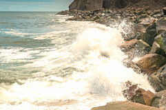 Ocean Waves breaking against rocky shoreline. Rough sea rocky shore Royalty Free Stock Image