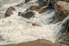 Ocean Waves breaking against rocky shoreline Royalty Free Stock Images