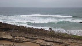 Ocean waves breaking. In a beach stock video