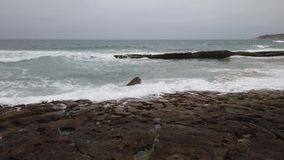 Ocean waves breaking. In a beach stock footage