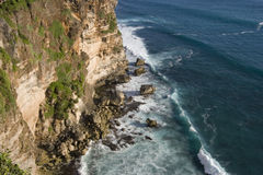 Ocean waves and Cliff. Waves from the ocean hitting against a rock cliff stock photos