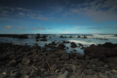Ocean waves crash on the lava rocky coast at Laupāhoehoe Point Royalty Free Stock Image