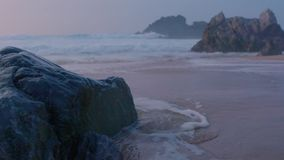 Ocean Waves Crash Into Rocks During Sunset. In super slow motion in Portugal. Amazing sunset view stock video footage