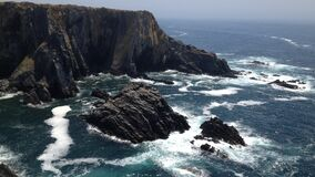 Ocean Waves Crashing Against Rocky Outcrops Stock Photos