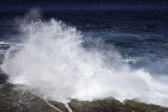 Ocean waves crashing on rocks Stock Image