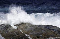 Ocean waves crashing on rocks Royalty Free Stock Image