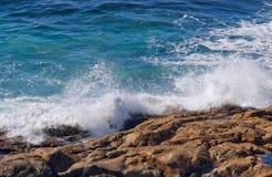 Ocean waves crashing on rocks stock photos