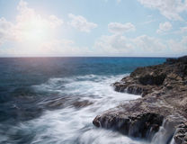 Ocean waves crashing on rocks. Waves crashing on rocks with a beautiful view of sky Royalty Free Stock Photos