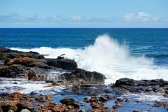 Ocean waves crashing on rocks Stock Image