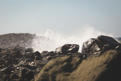 Ocean Waves Crashing into Rocky Shore Royalty Free Stock Image
