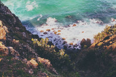Ocean Waves Crashing on Seashore and Rocks Seen from Mountain during Daytime Stock Image