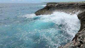Ocean waves crushing coastline stock video footage