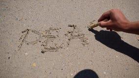 Ocean waves deleting word `Peace` stock video