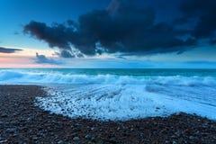 Ocean waves in dusk Stock Photos