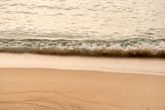 Ocean waves exhausted on the beach in the morning Stock Photography