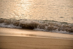 Ocean waves exhausted on the beach in the morning Royalty Free Stock Image
