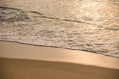 Ocean waves exhausted on the beach in the morning Royalty Free Stock Photo