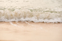 Ocean waves exhausted on the beach in the morning Stock Images