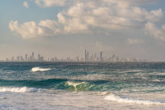 Ocean with waves and Gold Coast cityscape on the background Royalty Free Stock Image