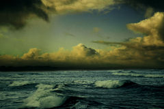 Ocean waves with golden clouds
