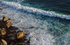 Ocean waves hitting rocks stock photo