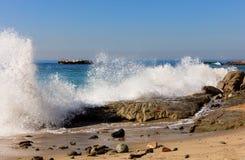 Ocean waves hitting rocks on Laguna Beach in California Royalty Free Stock Image