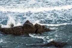 Ocean waves hitting rocks. Storm weather sea view Royalty Free Stock Image