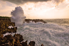 Ocean waves hitting rocky shore Stock Photos