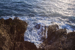 Ocean waves lapping on the rocks. View from above. Capstone Hill. Ilfracombe. North Devon. UK Stock Image