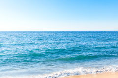 Ocean waves near the bank. On clear summer day Royalty Free Stock Images