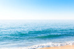 Ocean waves near the bank. On clear summer day Stock Photo