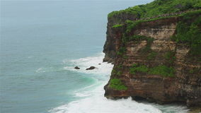 Ocean waves over high cliffs stock footage