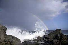Ocean waves and rainbow Stock Images