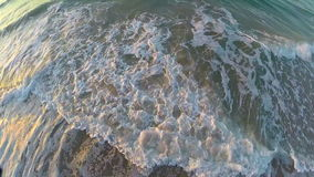 Ocean waves reflecting sunrise colors. Video of ocean waves reflecting sunrise colors stock footage