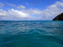 Ocean waves ripple and Makapuu point Royalty Free Stock Images
